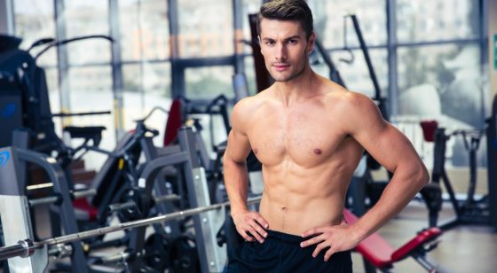 Handsome fitness man standing at gym
